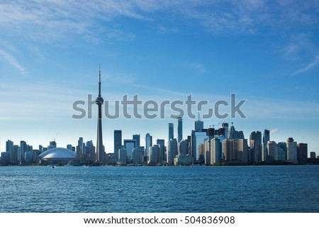 The skyline of Toronto, Canada viewed from the Toronto Islands on a sunny afternoon