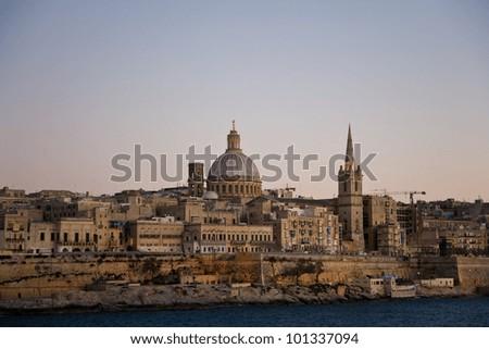 The skyline of Valletta, the capital of Malta, at sundown - stock photo