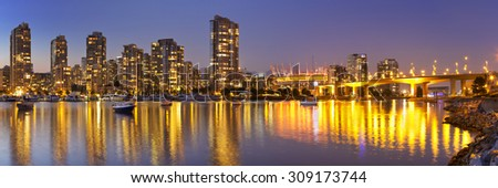 The skyline of Vancouver, British Columbia, Canada from across the water at dusk.