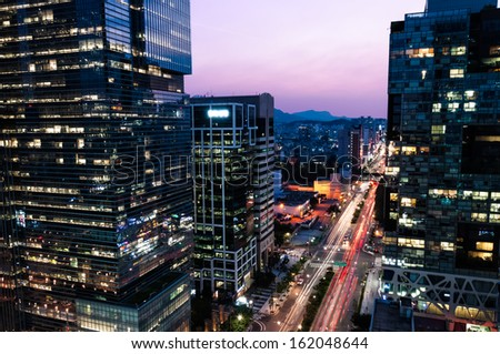 The skyscrapers of Gangnam at sunset in Seoul, South Korea. - stock photo