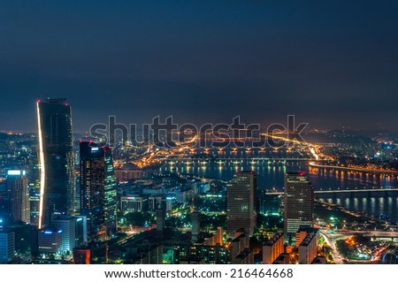 The skyscrapers of Seoul light up as evening comes on in South Korea. - stock photo
