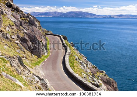 The Slea Head Drive is a circular route, beginning and ending in Dingle, that takes in a large number of attractions and stunning views on the western end of the peninsula in Ireland. - stock photo
