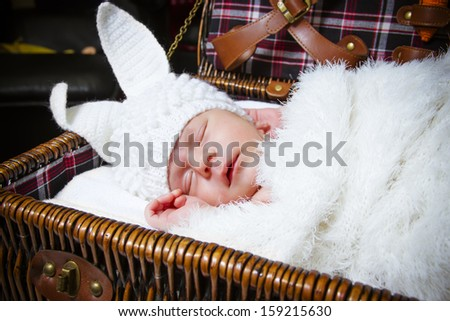 the sleeping baby in a suit of a rabbit - stock photo