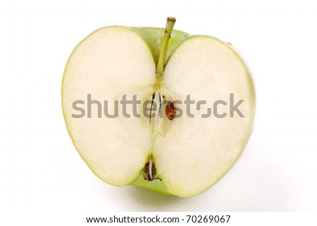 The sliced green apple on white - stock photo