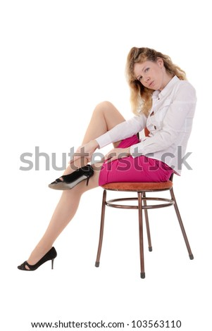 the slim girl on a chair, isolated on white