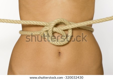 The slim waist pressed a rope.  - stock photo