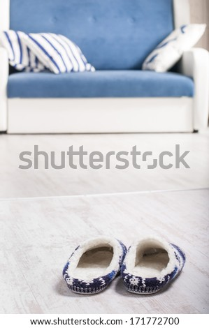 The slippers  and sofa - stock photo