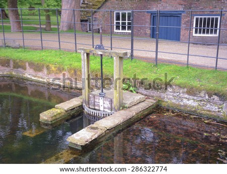 The Sluice Gate at the Water Mill at Dunham Massey, Cheshire, England, UK - stock photo