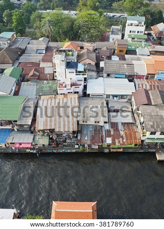 The Slum near riverside, group of house is close, riverside home in danger, unsafe space, city with old plan, Bangkok Thailand