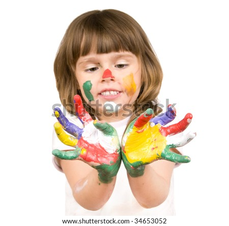 The small beautiful girl has stretched to a camera of a palm soiled in a paint of different colors, smiles, closeup, on white background.