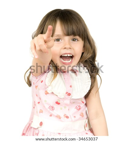 The small beautiful girl is dared, shouts, shows a finger of a hand in a direction of a camera, on white background.