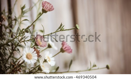 The small bouquet of flowers in many colors