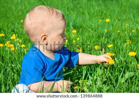 the small child on a summer meadow - stock photo