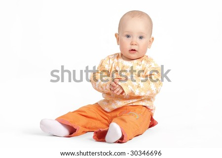 The small child on a white background