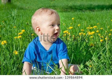 the small child smiles - stock photo