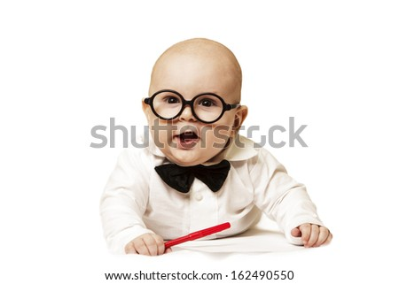 The small child wearing spectacles and with the pen on a white background