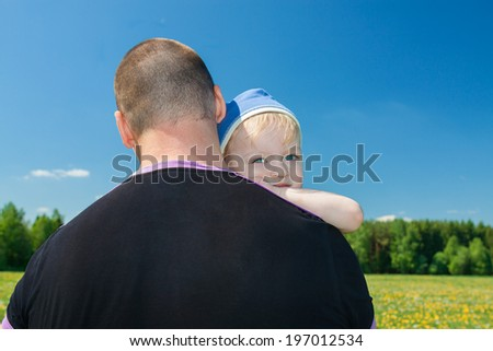 the small child with the father on walk in park - stock photo