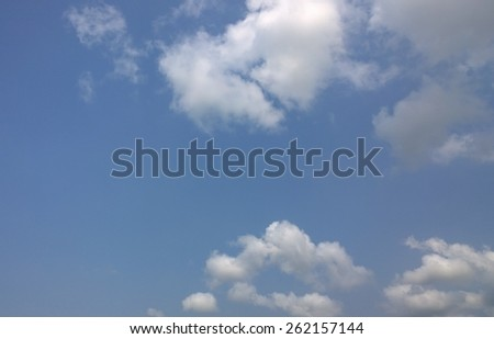 The small fluffy cloud is on the sky - stock photo