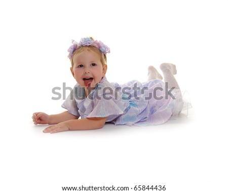The small nice girl in the lilac dress