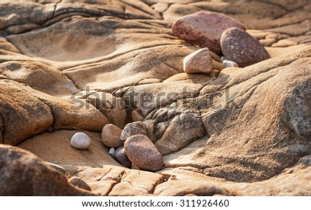 the small stones on a Sandstone Rock - stock photo
