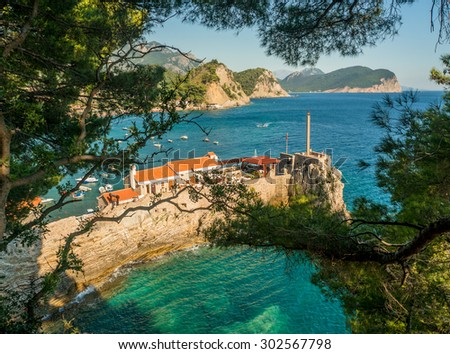 The small town of Petrovac on the beautiful Mediterranean coast in Montenegro is not far from Budva. - stock photo