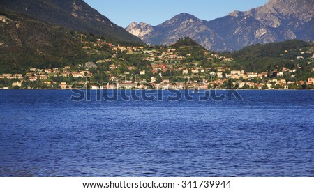 the small town surrounded by the large lake ,lake como Italy - stock photo