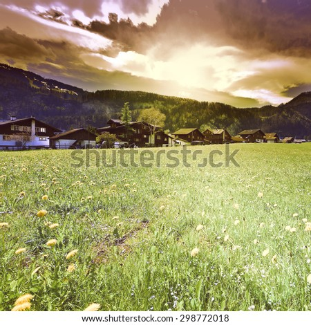 The Small Village High Up in the Swiss Alps at Sunset, Vintage Style Toned Picture - stock photo