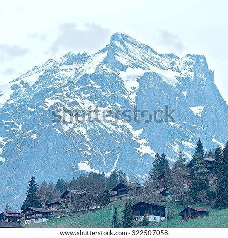 The Small Village High Up in the Swiss Alps, Vintage Style Toned Picture - stock photo