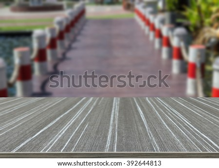 the small wooden bridge across the pond (blur background and wooden table for displaying your product)