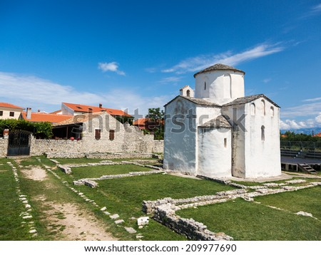 The smallest cathedral in the world, church of the Holy cross, built in the 9th century. - stock photo