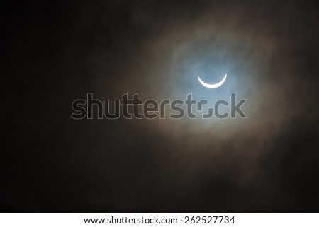 The smiling face of the sun - Solar Eclipse, the UK on 20 March 2015 - stock photo