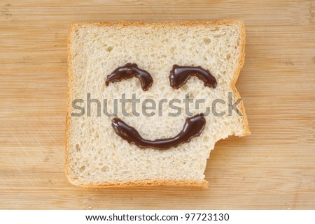 The smiling faces painted on the bread