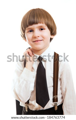 the smiling little boy in the role of the boss - stock photo