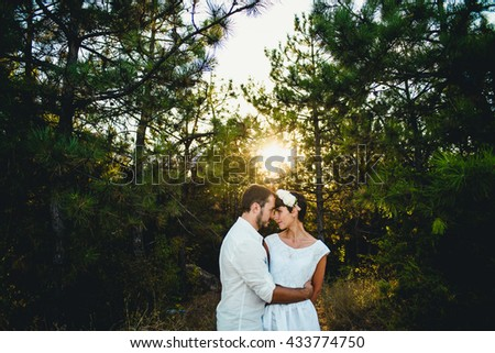 The smilling couple in love looking at each other - stock photo