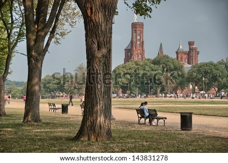 The Smithsonian Castle and Park, Washington, DC. - stock photo