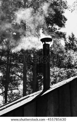The smoke coming from the chimney - stock photo