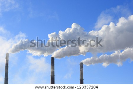 The smoke from the chimney against the sky - stock photo