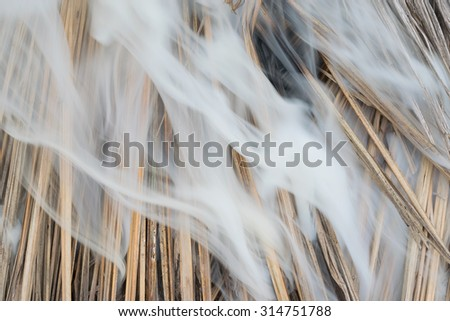 The smoke was burning straw. - stock photo