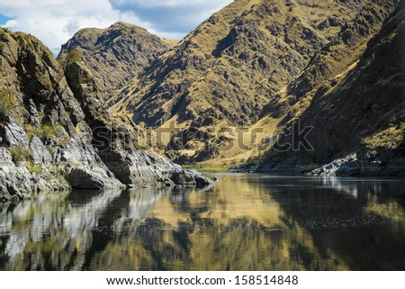 The snake River flowing through Hells Canyon in Idaho - stock photo