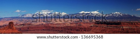 The snow-capped La Sal range as seen from Dead Horse Point in early spring - stock photo