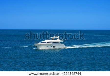 The snow-white yacht is moving at high speed across the sea - stock photo