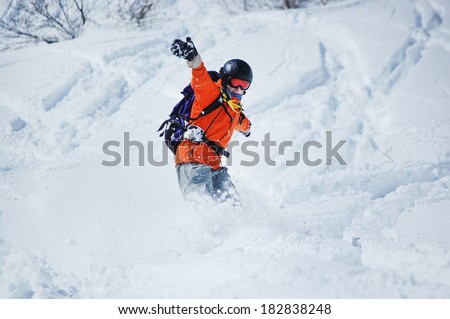 The snowboarder in action at the mountains - stock photo