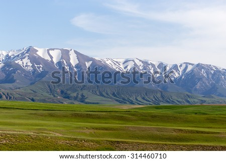 the snowy peaks of the Tien Shan Mountains. Kazakhstan - stock photo