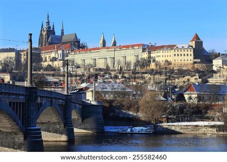 The snowy Prague gothic Castle above the River Vltava, Czech Republic - stock photo