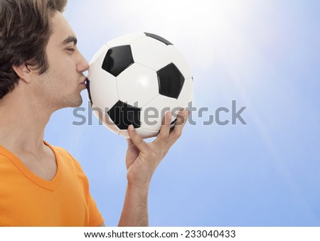 The soccer kiss the ball