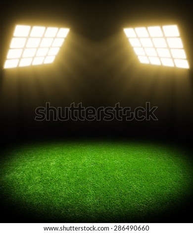 the soccer stadium with the bright lights - stock photo