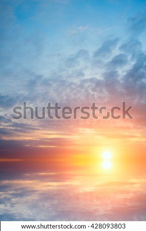The soft setting sun and waves. Natural composition of sea sunset