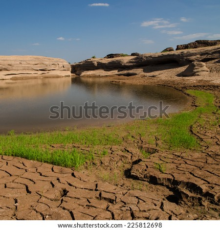 The soil in dry season, Grass on the dry ground. - stock photo