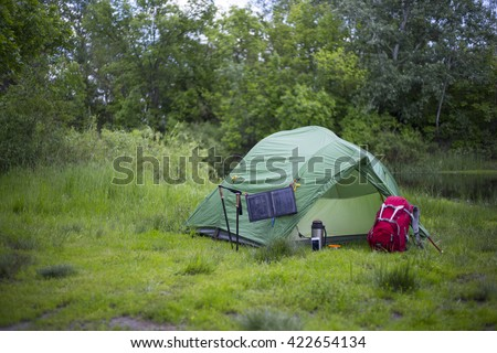 The solar panel attached to the tent. - stock photo