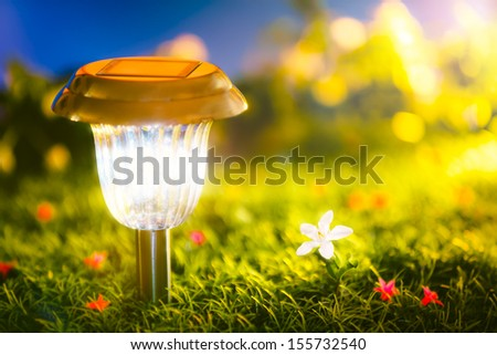 The solar power lamp make the light from clean energy. - stock photo